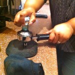 Tamping the coffee