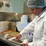 Micah Carr-Hill prepares pieces of chocolate with different types of salt.