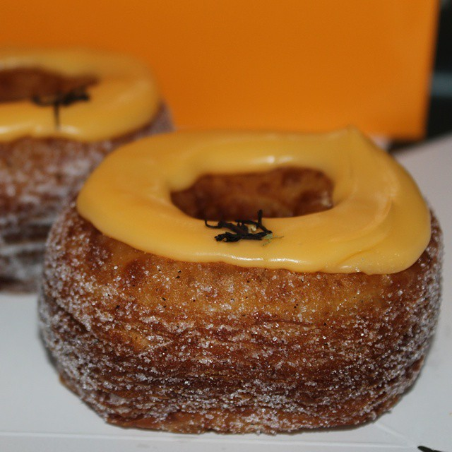 In the box... 2 beautiful yellow peach & black tea Cronuts™ from @dominiqueansel @giftlibrary #cronut