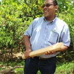 Dr Sukha with a cacao mallet
